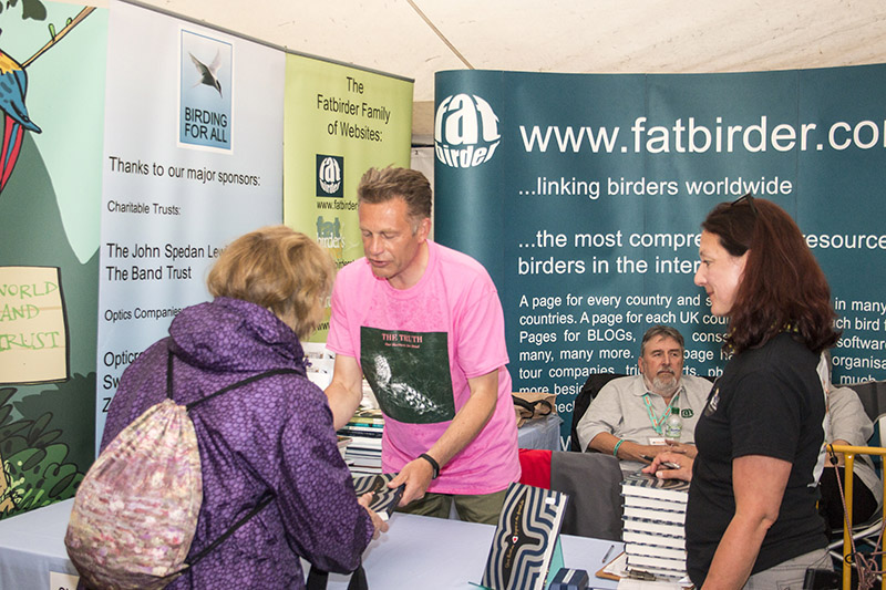"""Chris Packham signing his book """"Fingers in the Sparkle Jar"""" on the Birding For All stand 2016 birdfair"""